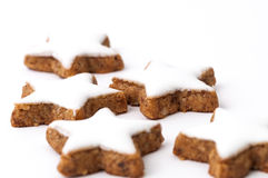 Christmas cookies on a white background. Some star-shaped cinnamon biscuits on a white background Stock Photography