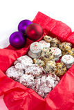 Christmas Cookies on a white background. An assortment of Christmas Cookies in a red tissue lined box stock photos