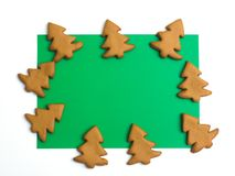 Christmas cookies on white green background. Christmas baking. Making gingerbread christmas cookies. Christmas concept. Royalty Free Stock Images