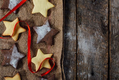 Christmas cookies on wooden background. Christmas cookies from above on wooden background with blank space Royalty Free Stock Images