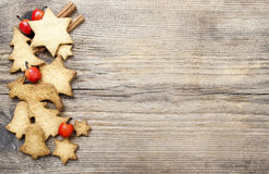 Christmas cookies on wooden background. Royalty Free Stock Images