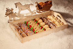 Christmas cookies on wooden plate Stock Photo