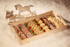 Christmas cookies on wooden plate Royalty Free Stock Photo