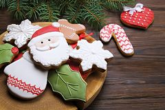 Christmas cookies on wooden table with fir branch close up Royalty Free Stock Photos