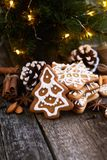 Christmas cookies on a wooden table. With christmas lights Stock Photo