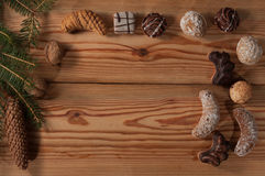 Christmas cookies on wooden table, table decorated with spruce t royalty free stock photography