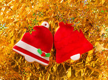 Christmas cookies Xmas red bell shape on golden Royalty Free Stock Image