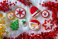 Christmas cookies Xmas tree Santa snowflake on white fur Royalty Free Stock Photography