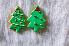 Christmas cookies Xmas tree shape on white fur Stock Photo