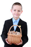 Christmas cookies for you. 8 years old boy with basket of Christmas cookies - kids stock photography