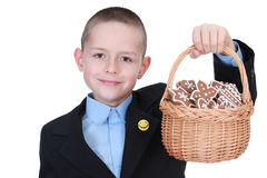 Christmas cookies for you. 8 years old boy with basket of Christmas cookies - kids stock image