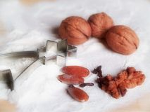 Christmas cooking. Three nuts and three almonds Stock Photography