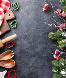 Christmas cooking utensils and snow tree. On stone table. Top view with copy space Stock Photos