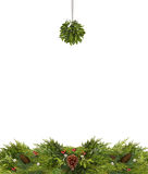 Christmas Copy Space With Mistletoe Ball and Pine Cones. Christmas copy space of mistletoe, holly berries, pine cones, and evergreen branches isolated on white Royalty Free Stock Photo
