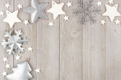 Christmas corner border with clay and metal ornaments on wood Royalty Free Stock Photos