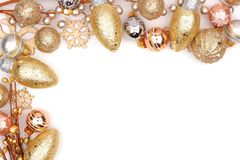 Christmas corner border of gold ornaments isolated on white Royalty Free Stock Photos