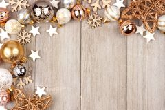 White and gold Christmas ornament corner border on wood Stock Photos