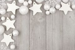 Christmas corner border with white ornaments on gray wood Royalty Free Stock Photo