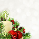 Christmas corner composition with pine twigs, candle and red bal Stock Photography