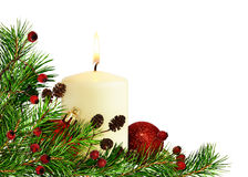 Christmas corner decoration with pine twigs, candle and balls Royalty Free Stock Photography