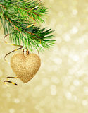 Christmas corner decoration with pine twigs and golden heart Royalty Free Stock Photos