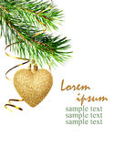Christmas corner decoration with pine twigs and golden heart. Isolated on white Royalty Free Stock Images