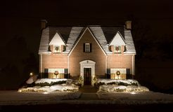 Christmas Cottage - night. Cute house decorated for Christmas at night Stock Photos