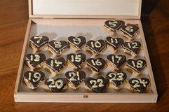 Christmas countdown – Advent calendar 5th dec. 20 days until Christmas Eve: the 6th of December - sweet hearts Advent calendar with 24 chocolate marzipan stock photo