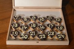 Christmas countdown – Advent calendar 7th dec. 18 days until Christmas Eve: the 6th of December - sweet hearts Advent calendar with 24 chocolate marzipan royalty free stock photos