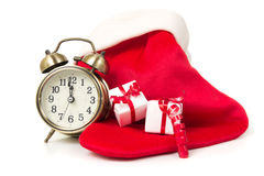 Christmas countdown. Clock with red sock and gift boxes Stock Image