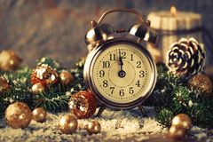 Christmas countdown to the new year. Clock and balls and fir spr. Uce branches. Holiday composition royalty free stock photo