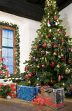 Christmas in the Country. Christmas Tree and Packages in a rural Living Room Stock Image