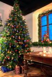 Christmas in Country Style. Christmas Tree in a rural Living Room Stock Photo