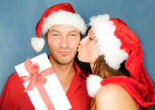 Christmas couple. Lovely christmas couple holding presents Royalty Free Stock Photo