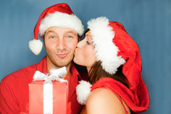 Christmas couple. Lovely christmas couple holding presents Royalty Free Stock Images