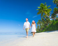 Christmas couple on the beach.  Royalty Free Stock Image