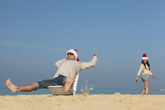 Christmas couple on a beach. Having fun Stock Photos