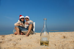 Christmas couple on a beach. Having fun Royalty Free Stock Images