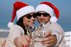 Christmas couple on a beach. Having fun Royalty Free Stock Image