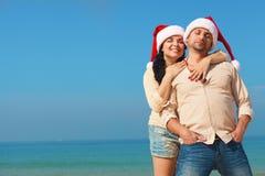 Christmas couple on a beach. Christmas couple having fun on a beach Stock Photo