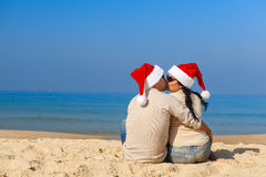 Christmas couple on a beach Royalty Free Stock Photo