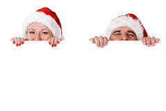 Christmas couple with Blank sign Stock Photography