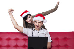 Christmas couple celebrate their success Stock Photography