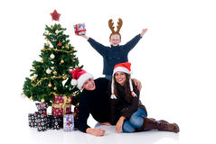 Christmas couple with child Stock Image