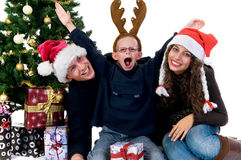 Christmas couple with child Stock Photos