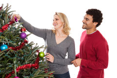 Christmas couple decorating tree Royalty Free Stock Photo