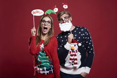 Christmas couple. Couple with funny christmas masks Stock Photo