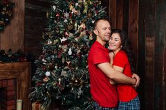 Christmas Couple.Happy Smiling Family at home celebrating.New Year People stock photos