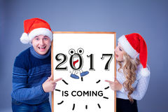 Christmas couple holding white board with empty copy space stock photo