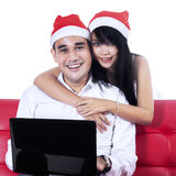 Christmas couple with a laptop Royalty Free Stock Image